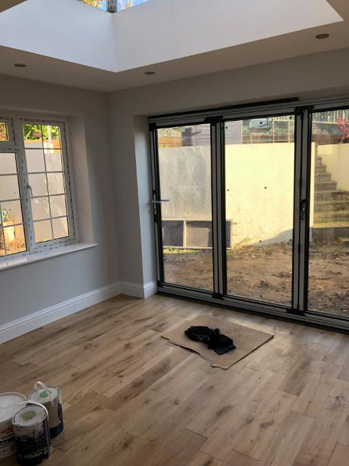 white pvcu window, white bifold doors